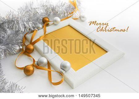New Year and Christmas greeting card template made of white frame and yellow card with yellow ribbon silver and yellow balls and silver tinsel with copy space horizontal view