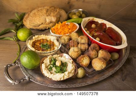 Hummus and falafel on a silver tray