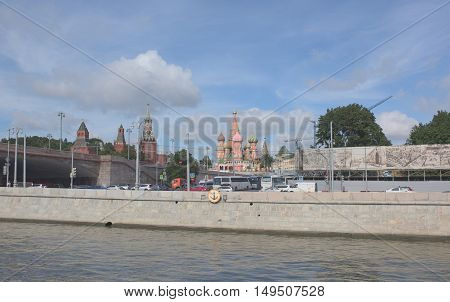 Moscow Russia -September 06 2016: View of the Kremlin from the Moskva River by Vasilevsky descent.On the waterfront are moving people and vehicles