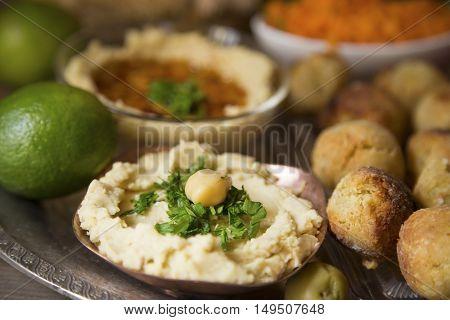 Traditional ummus dip and falafel close up