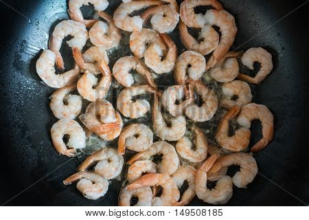 Cooking shrimp in pan in the kitchen at the restaurant