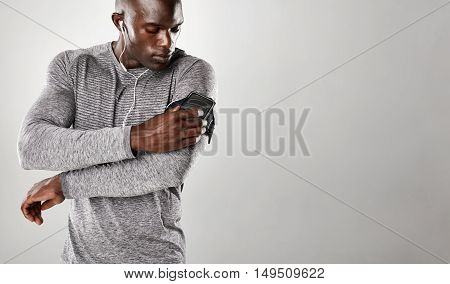 African Male Listening To Music On Mobile Phone