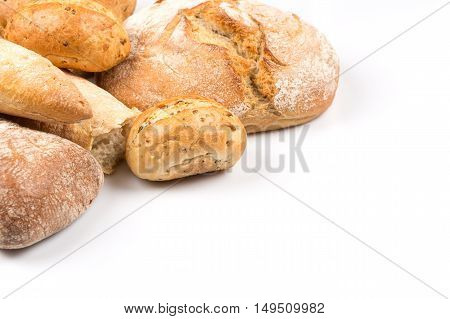 Composition with bread buns and rolls isolated on white background