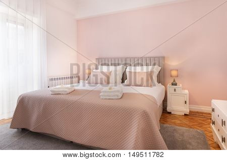Beautiful and bright bedroom with pink sheets