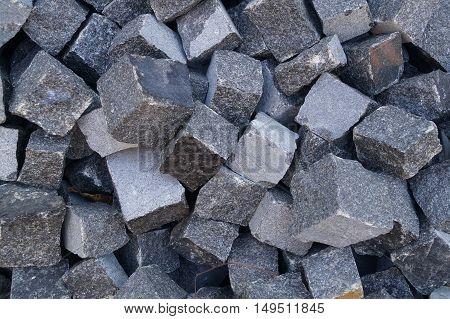 Pile of grey cube granite stones, texture