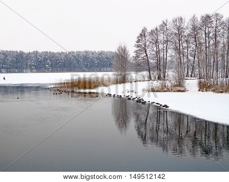 View of the river and frozen lake