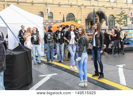 St. Petersburg, Russia - 12 August, Young people at the festival Harley Davidson,12 August, 2016. The annual International Festival of Motor Harley Davidson in St. Petersburg Ostrovsky Square.