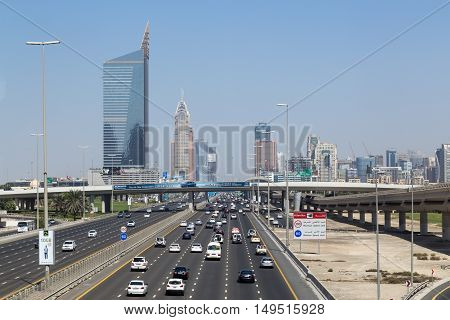 Dubai, United Arab Emirates - October 17, 2014: A wide highway with skyscraper skyline in the background
