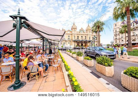Monte Carlo, Monaco - June 13, 2016: People sit at the famous cafe de Paris near Monte Carlo casino in Monaco