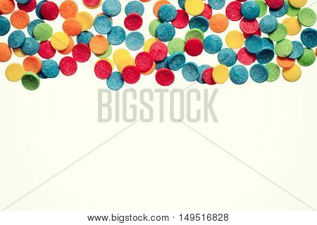 Colorful confetti background with place for text. Party backdrop.