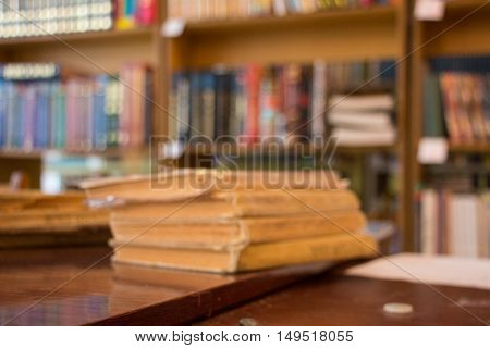 Unfocused Blurred old books on the table