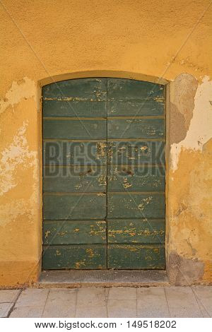 An old wooden door in Marano Lagunare in Friuli Venezia Giulia north east Italy.