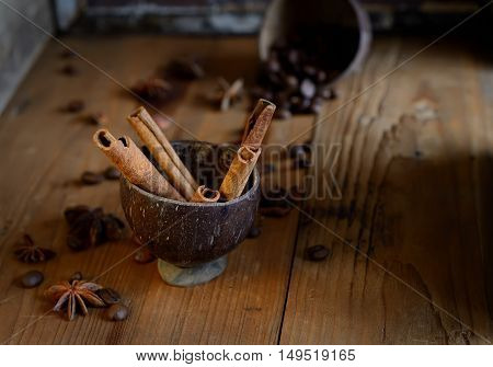coffee beans, star anise, cinnamon on wooden background