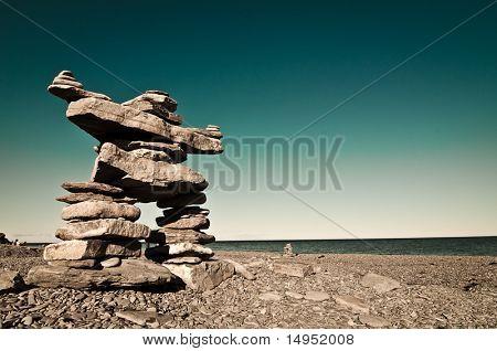 Amerindian statue on a beach