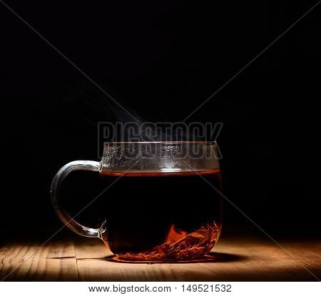 glass cup with tea on a black background
