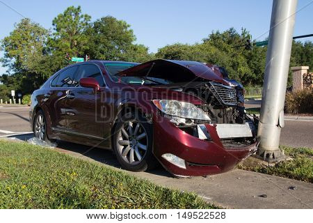 JACKSONVILLE, FLORIDA, USA - SEPTEMBER 23, 2016: A car crashes into a lightpole during the morning commute. In 2015, there were 374,445 reported car crashes in Florida.