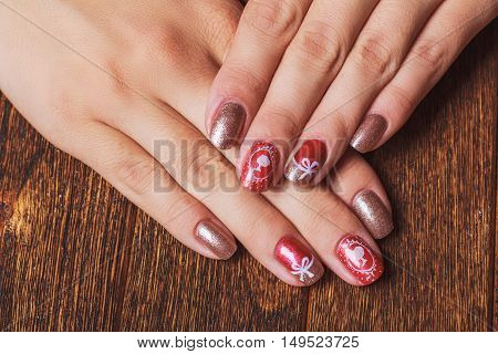 Festive Nail Art In Pink And Gold Colors