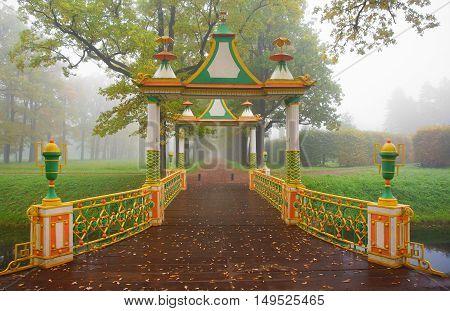 Foggy morning and Chinese bridge in Alexander Park in Tsarskoye Selo