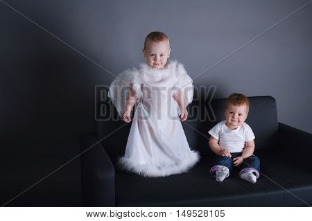 photo of little girl and boy in angel dress