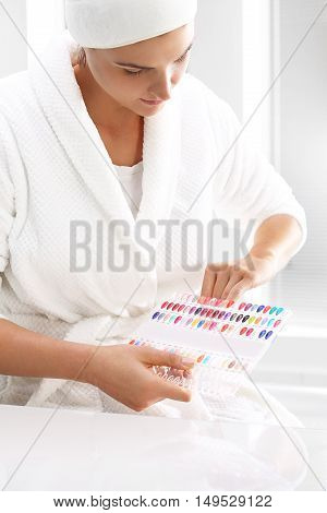 Hand care in the spa salon. Color palette of nail polishes.