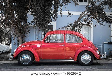 NEREZINE, CROATIA - SEPTEMBER 17: Red retro car Volkswagen Beetle parked at the city street on September 17, 2016 in Nerezine, Croatia.