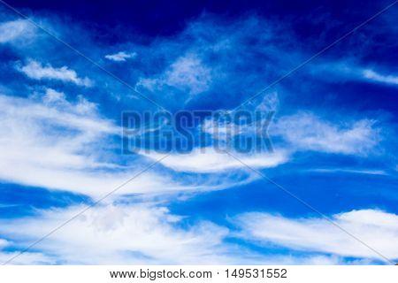 white clouds in the blue sky, clean air