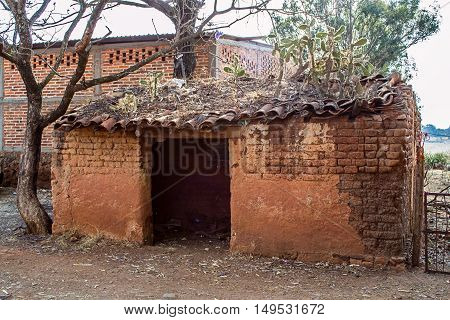 Horizontal photo of an old adobe house in a ranch