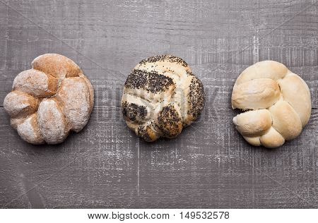 Fresh bread rolls for breakfast morning on wooden table in cafe