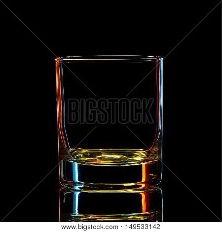 Silhouette of colorful strong liquor classic glass with clipping path on black background.