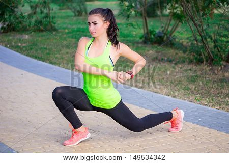 Young Fitness Girl Does Lunges During Training Workout