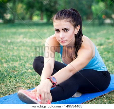 Young Fitness Girl Stretching Legs For Training Workout