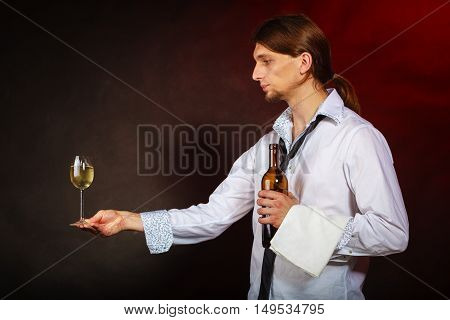 Waiter Serving Wine Bottle.