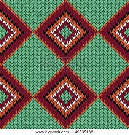 Knitting Seamless Quadrate Pattern In Warm Colors Over Green