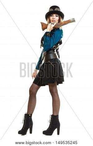 Retro old fantasy fashion style. Young pretty woman with vintage pistol isolated on white.