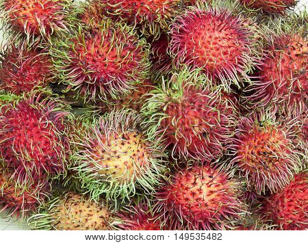 rambutan sweet delicious Thai fruit on wood background.