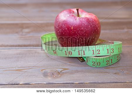 Red Apples With Measuring Tape On Woden Table