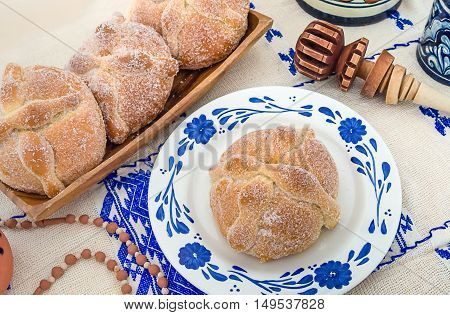 Sweet bread called Bread of the Dead (Pan de Muerto) enjoyed during Day of the Dead festivities in Mexico.