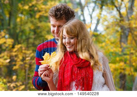 Couple Playing With Leaf In Autumn Park