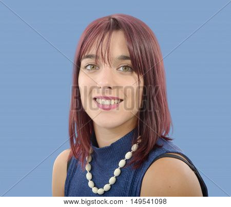 portrait of beautiful young woman with red hairs blue background
