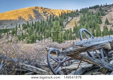 ruins of gold mine near Mosquito Pass in Rocky Mountains, Colorado - parts of aerial tramway used to transport gold ore