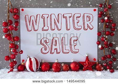 Label With English Text Winter Sale. Red Christmas Decoration Like Balls On Snow. Urban And Modern Cement Wall As Background With Snowflakes.