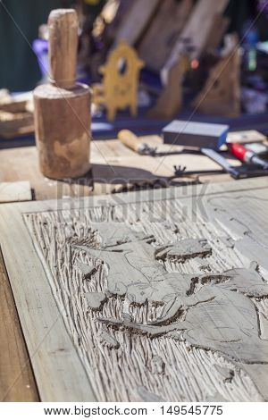 Craftsman table with tools for engrave wooden crafts