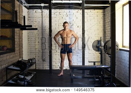 Muscular man standing at gym. Concept workout healthy lifestyle sport