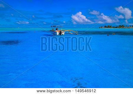 Boat in the blue lagoon of Bora Bora French Polynesia