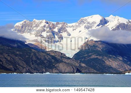Snow capped mountain clouds and lake in El Calafate Patagonia Argentina
