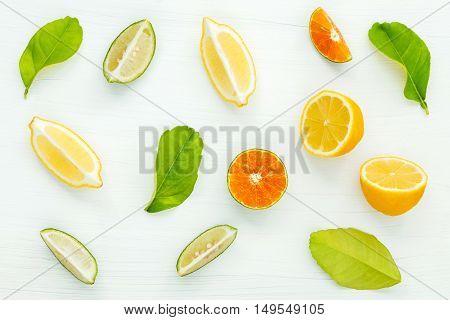 Mixed Fresh Citrus Fruits And Leaves Background. Fresh Lemons, Lemon Slice ,lime And Orange On White