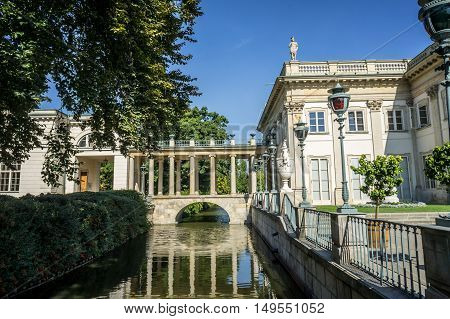 WARSAW POLAND - SEPTEMBER 27: Little bridge with columned gallery on the Lazienki canal near the Lazienki Palace the Palace on the Water in Royal Baths Park Lazienki Park in Warsaw Poland on September 27 2016
