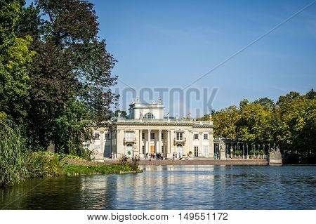 WARSAW POLAND - SEPTEMBER 27: View of the Lazienki Palace the Palace on the Water in Lazienki Park or Royal Baths Park in Warsaw Poland on September 27 2016