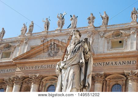 Vatican, Vatican - October 11, 2014. Upper section of the facade of St Peters Basilica in Vatican, with religious sculptures.