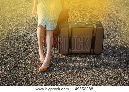 A woman traveller with a vintage lugguage